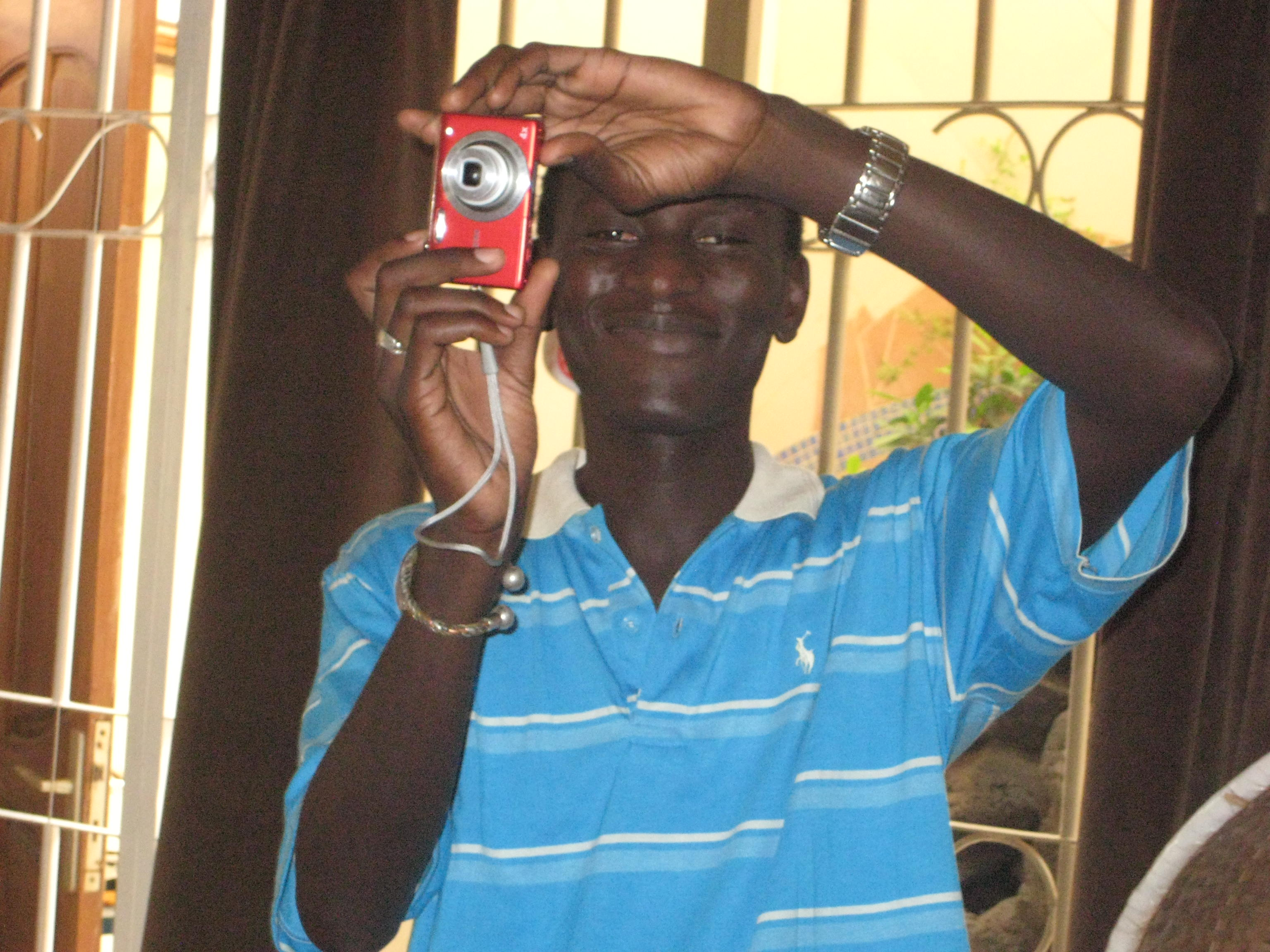 Tidiane with digital camera ... have grave concerns about the modelling agency who represent Blondeau, ...