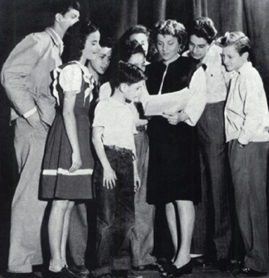 Viola Spolin surrounded by kids